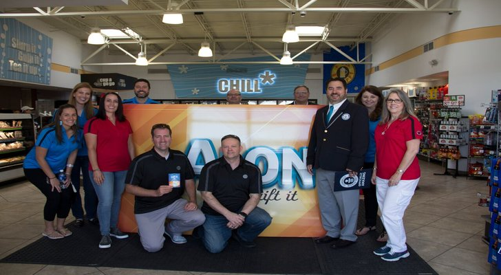 Alon Brands Inc. team members join representatives from Guinness World Records as the retailer sets the record for the World's Largest Gift Card.