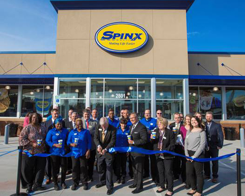 Joined by SPINX associates, Stewart Spinks, SPINX founder and chairman, cuts the ribbon to officially mark the grand opening of the newest Spinx location in Moncks Corner.
