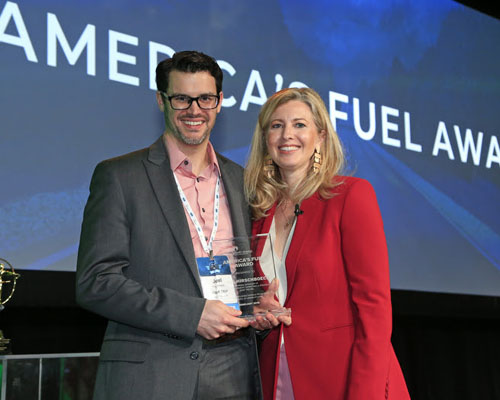 Kwik Trip's Joel Hirschboeck accepts the America's Fuel Award from Growth Energy CEO Emily Skor.