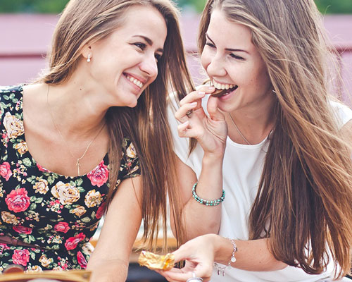 female millennials snacking