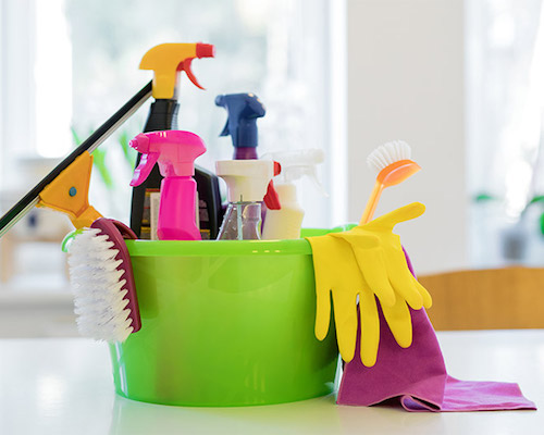 cleaning supplies in a bucket with gloves