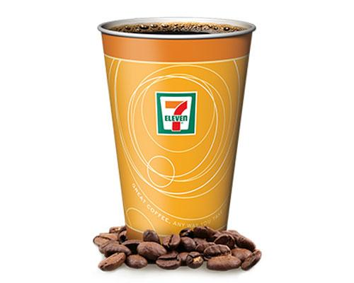 cup of 7-Eleven coffee with coffee beans