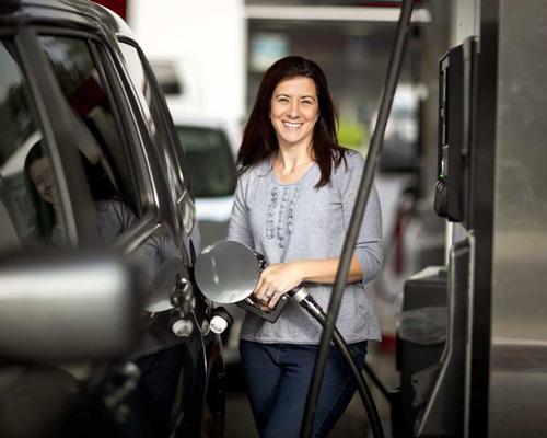 female pumping gas