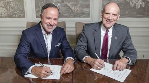 Parker's CEO Greg Parker, left, signs a landmark gift agreement with Georgia Southern University's College of Business Dean Allen C. Amason.