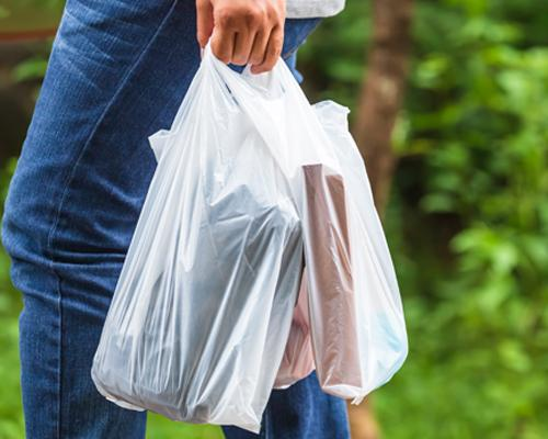 A shopper with single-use plastic bags