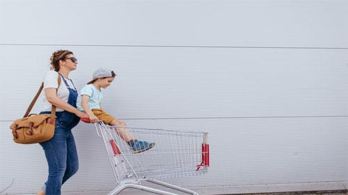 mom pushing shopping cart