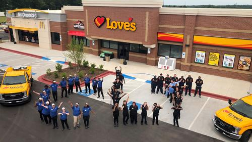 Love's team members welcome customers at a new travel stop in Charlotte, N.C.