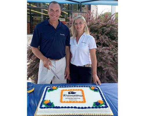 Dean Beck, senior vice president business development and co-owner, and Chelsea Carvalho, retail operations, celebrate the grand re-opening of a Friendship Kitchen in Wakeman, Ohio.