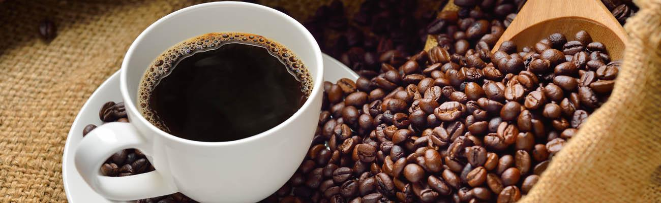 A coffee cup and coffee beans