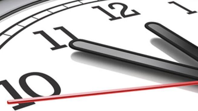 A close up image of a wall clock