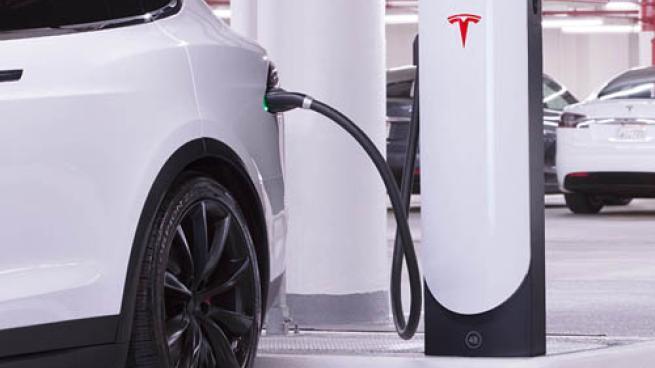 A car parked at a Tesla Supercharging station