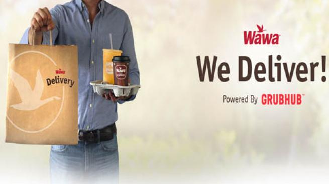 An image of a delivery person carrying a Wawa bag.