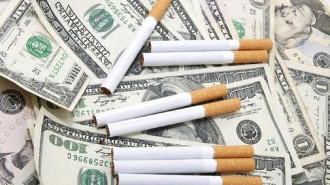 Cigarettes laying on top of money