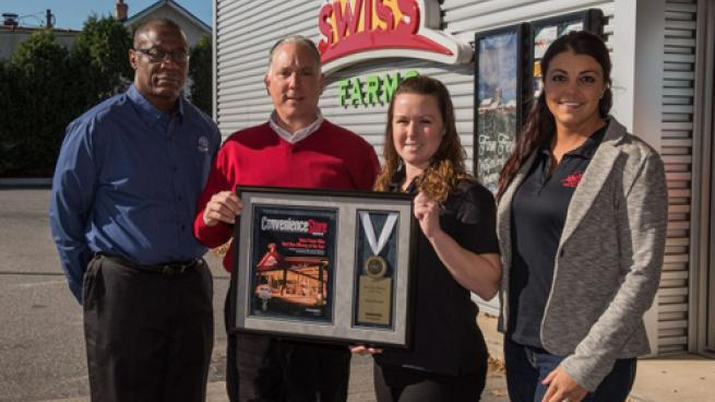 Ken McAllister (left) of Tyson Convenience presents Convenience Store News Foodservice Innovator of the Year award to Swiss Farms President and CEO Scott Simon, Fresh Food Manager Valerie O'Neill, and Brand Manager Caley Smith (far right).