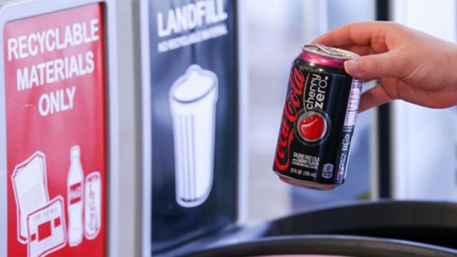 A Coke Zero can being recycled