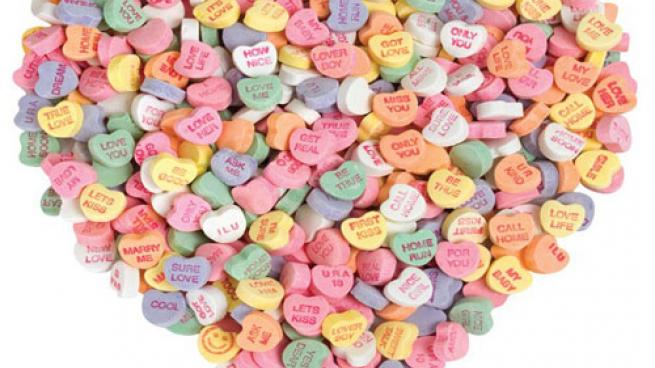 Candy hearts making up a giant heart