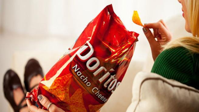 female eating Doritos