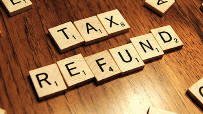 Scrabble tiles spell out tax refund