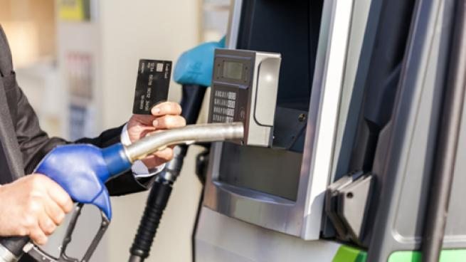 Paying with a credit card at the gas pump