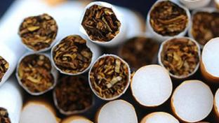 An image of cigarettes stacked on top of each other