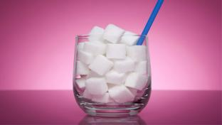 glass with sugar cubes