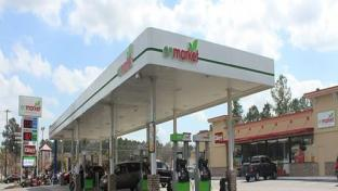 The exterior of an Enmarket convenience store and gas station