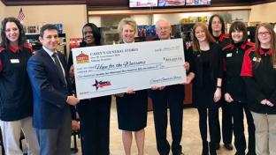 Casey's check presentation to Hope For The Warriros