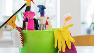 cleaning supplies in bucket with gloves