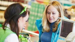 c-store female shopper at checkout