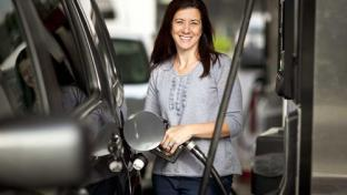 female pumping gas