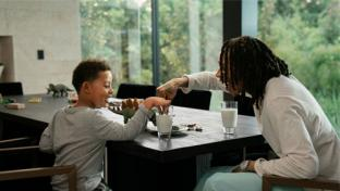 "Musician Wiz Khalifa and his five-year-old son, Sebastian, in the brand's newest TV ad for ""Stay Playful."""