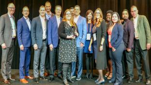InComm team members accept the 7-Eleven Vendor Partner of the Year award.