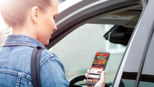 A woman using Casey's mobile app