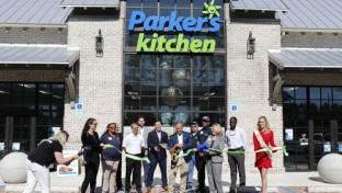 Parker's Kitchen founder and CEO Greg Parker, center, recently cut the ribbon at a new store located at the Cane Bay Shopping Center in Summerville, S.C.