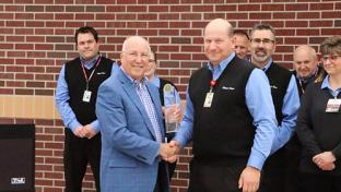Kwik Trip Foodservice Director Paul Servais (right) accepts the Foodservice Innovator of the Year award from Convenience Store News Editorial Director Don Longo.