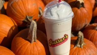Rutter's Pumpkin Pie Milkshake with pumpkins