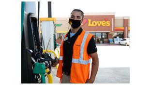 A Love's employee wearing a mask