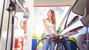 a woman pumping gas